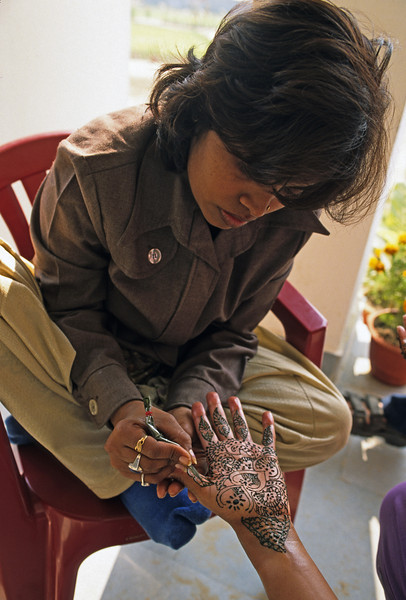 L1880 Traditional painting of henna on hands of a bride to be.
