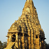 L1967 Kandariya Mahadeva Temple. The 3rd chakra, manipura, orients around power, and is less graphic in depiction.