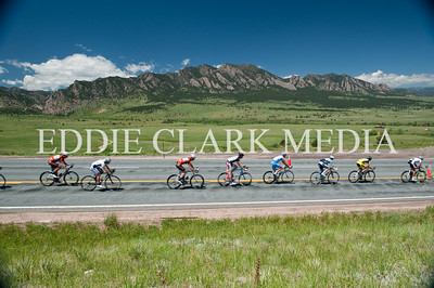 Racers streak down Highway 93 with a stellar view of Eldorado Canyon and the Flatirons.