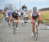 Gilbert launches his attack at the front as the cobbles continue...