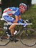 Hincapie is feeling the pace now as the race speeds along the cobblestones near Volkegem...