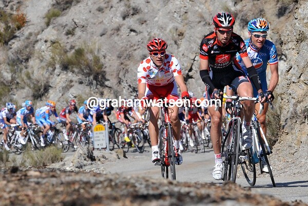 Three men emerge ahead of the race halfway up the climb - Perguet, Voeckler and Moinard...