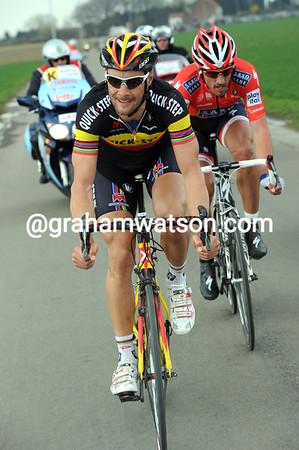 Boonen has got across to Cancellara, but it hurts a bit...