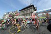 The peloton slips away from the historic centre of Antwerp on its way to Schoten...
