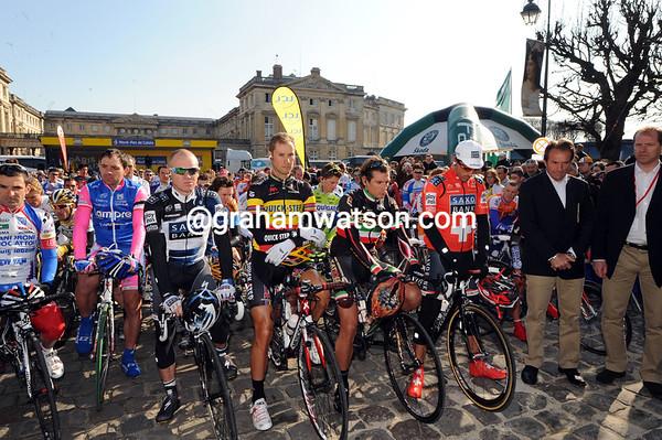 Paris-Roubaix veterans like Stuart O'Grady, Tom Boonen, Flippo Pozzato and Gilbert Duclos-Lassalle pose for a minute's silence for Franco Ballerini in Compiegne...