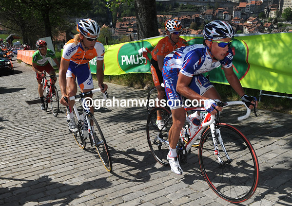 Mikhail Ignatiev leads the escape up the cobbled climb in Fribourg - they are still a few minutes in front...