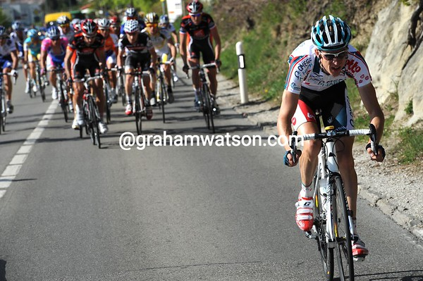 Charly Wegelius attacks from a leading group of about 100 riders after that cobbled climb...