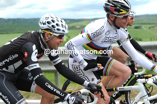Friends - Cadel Evans and Carlos Sastre swap notes on yesterday's decisive stage...