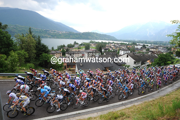 A sleepy peloton climbs away from Lake Garda at the start of a very short stage...