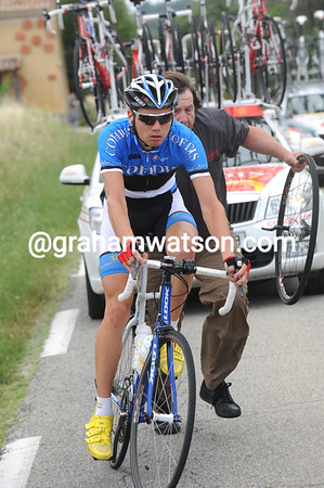 Rein Taaramae changes bikes as well - at least the peloton has slowed down now...