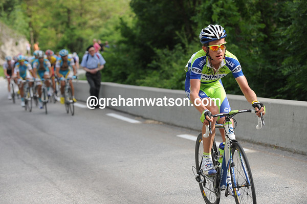 Sylvester Szmyd attacks from the peloton two minutes later...