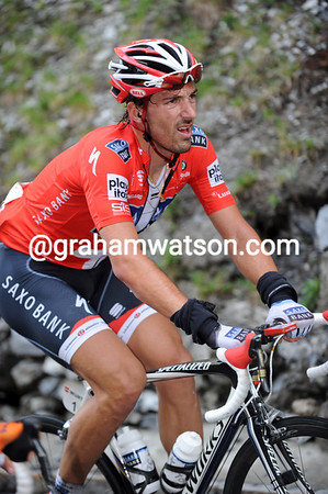Incredibly, it is Fabian Cancellara who cracks first with ten-kilometres of climbing still left...