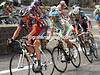 Lance Armstrong has a determined face as he leads Alberto Contador and Andy Schleck through a bend...