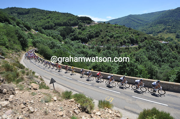 The stage is as pretty as it is fast - Saxo Bank lead the way up the first big climb...