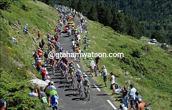 About 25 riders are still together near the top of the Pailheres...