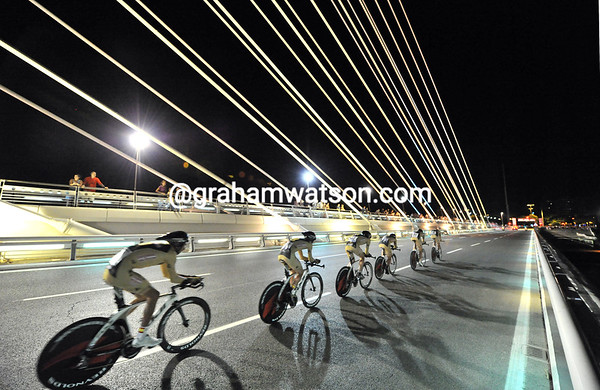 Spanish knights - Footon-Servetto races across one of Seville's futuristic bridges at nightime..