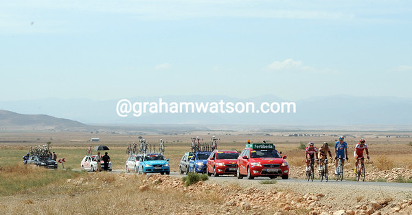 The four escapers look lost against such a remote landscape - they still have five minutes with 80-kilometres to go..