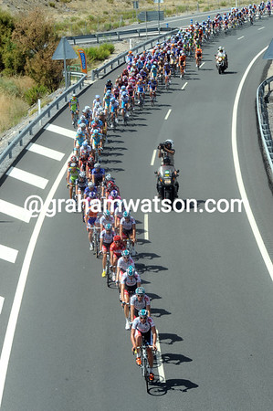 The peloton is led in a gentle pursuit by Omega-Lotto - but they are eight minutes down...