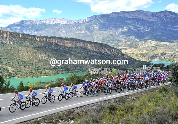 Spectacular scenery as Garmin leads the peloton through a canyon in Catalonia, high above the Embalse of Santa Ana...