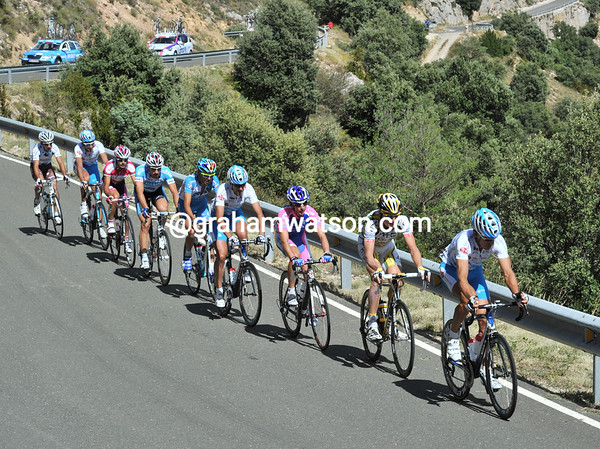 The six escapers have become nine on the long climb, after two Xacobea riders came across from the peloton...