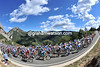 The peloton scales the Col de Boixeis under blue skies and warm sunshine...