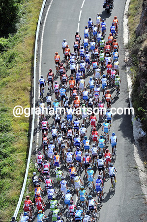 We are not in the mountains today, but the peloton is climbing the Alto de Pradilla as if it was a mountain...