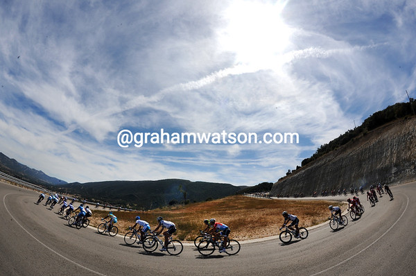 The peloton swoops down the mountain as well - four minutes behind the two Davids...