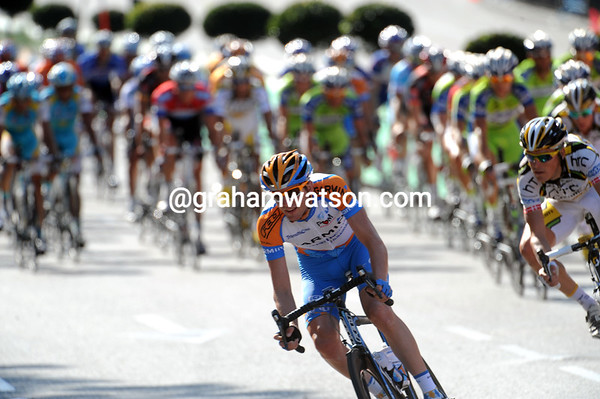Thomas Peterson swoops through a corner, ensuring the peloton's chase does not slow up...