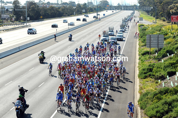 The peloton is in no rush as it enjoys the safety of a closed highway for an hour or so...