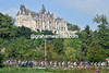 The peloton crosses the Loir with a huge Chateau towering over them...