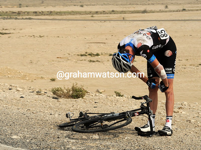 Daniel Lloyd has fallen off the road and looks cut and bruised by the sand and stones...