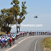 The TV helicopter is filming a peloton in full flight...