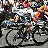 Mark Cavendish changes a wheel after tangling with an Euskatel rider - it's not been his week at all..!
