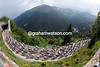 The peloton climbs the picturesque Passo di Monte Croce Carnico on the way over to Austria...