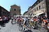 The peloton sweeps through an ancient town on on its way south...
