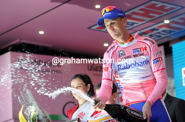 Peter Weening sprays the audience with sparkling wine, he'll be race-leader for at least another day...