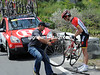 A Radio Shack mechanic comes to the aid of Phillip Deignan on the long and fast descent...
