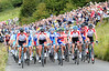 3,000 fenced-in fans greet the race with the England and GB teams guarding the peloton...