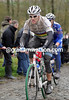 World Champion, Thor Hushovd, has Tom Boonen on his wheel on the Molenberg...