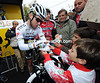 Sign please! Mark Cavendish obliiges a young fan at the start...