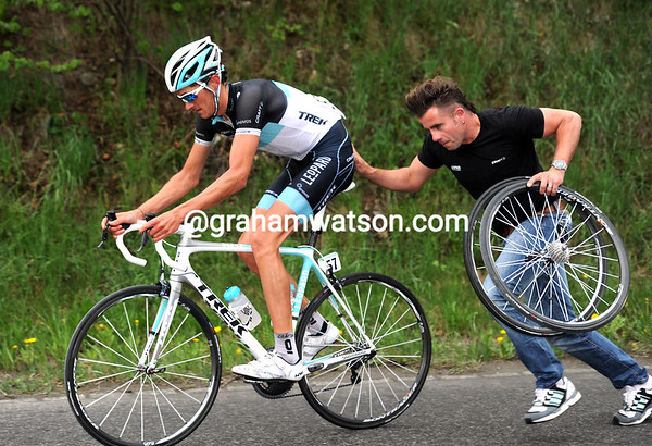 Brice Feillu needs a push and some tender loving care after a flat tyre...