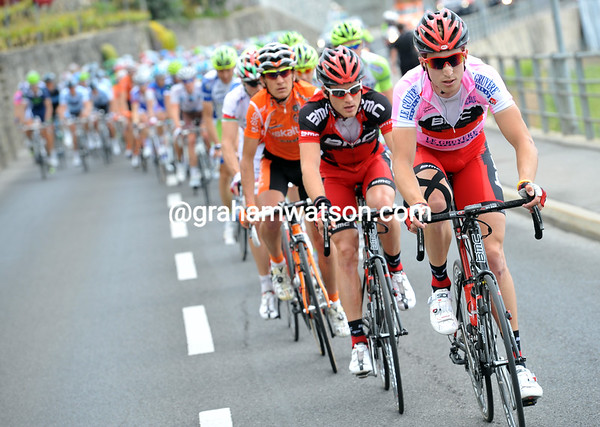 It's a pursuiter's battle - Taylor Phinney leads the peloton along the valley near Montreux...