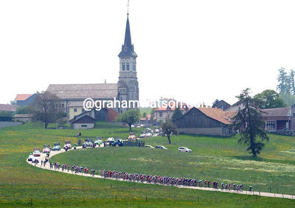 The peloton is still together after 75-kilometres of racing across some picturesque landscapes...