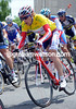Pavel Brutt is near the head of the peloton as it climbs the steep hill out of Neuchatel...