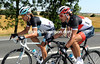 Linus Gerdemann paces Fabian Cancellara after the new Swiss champion changed a wheel...