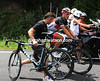 Leopard's nimble mechanic pushes Cancellara along while carrying the spare bike - now that's not easy..!