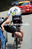 Tom Danielson gets some agile mechanical work on his bike after the Portet d'Aspet descent...
