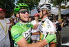 Further back, Cavendish thanks Peter Velits for his lead-out help...