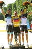 Andy and Franck Schleck pose with Cadel Evans...