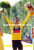 Cadel Evans is all smiles as he poses in his final Yellow Jersey of this Tour...